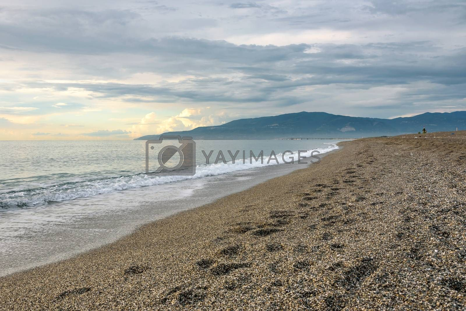 Evening view of a gravel beach at the Tyrrhenian Sea in Calabria, Italy