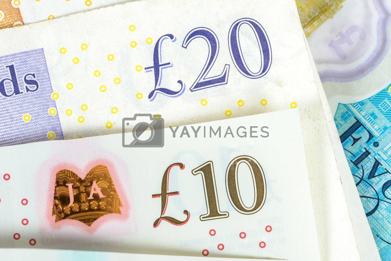 Closeup of 10 and 20 pounds banknotes. Financial background