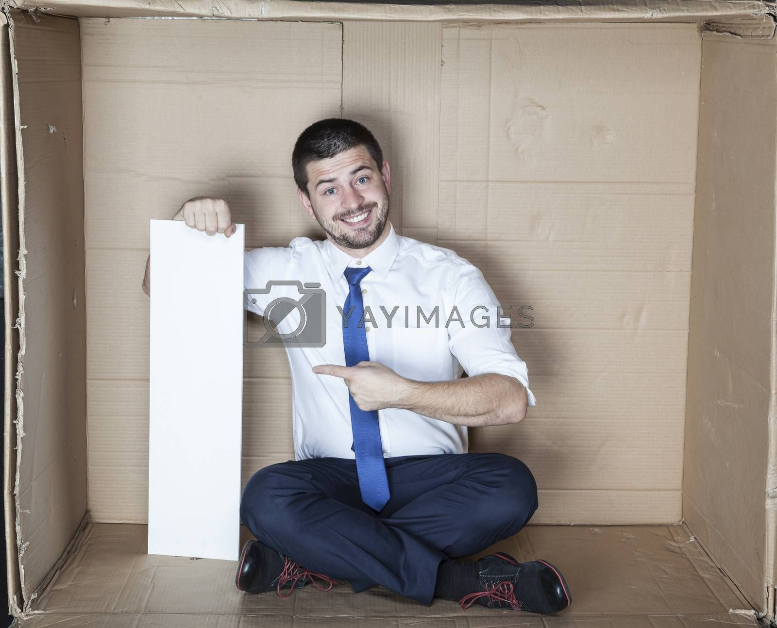 builder on a white background, pointing at you