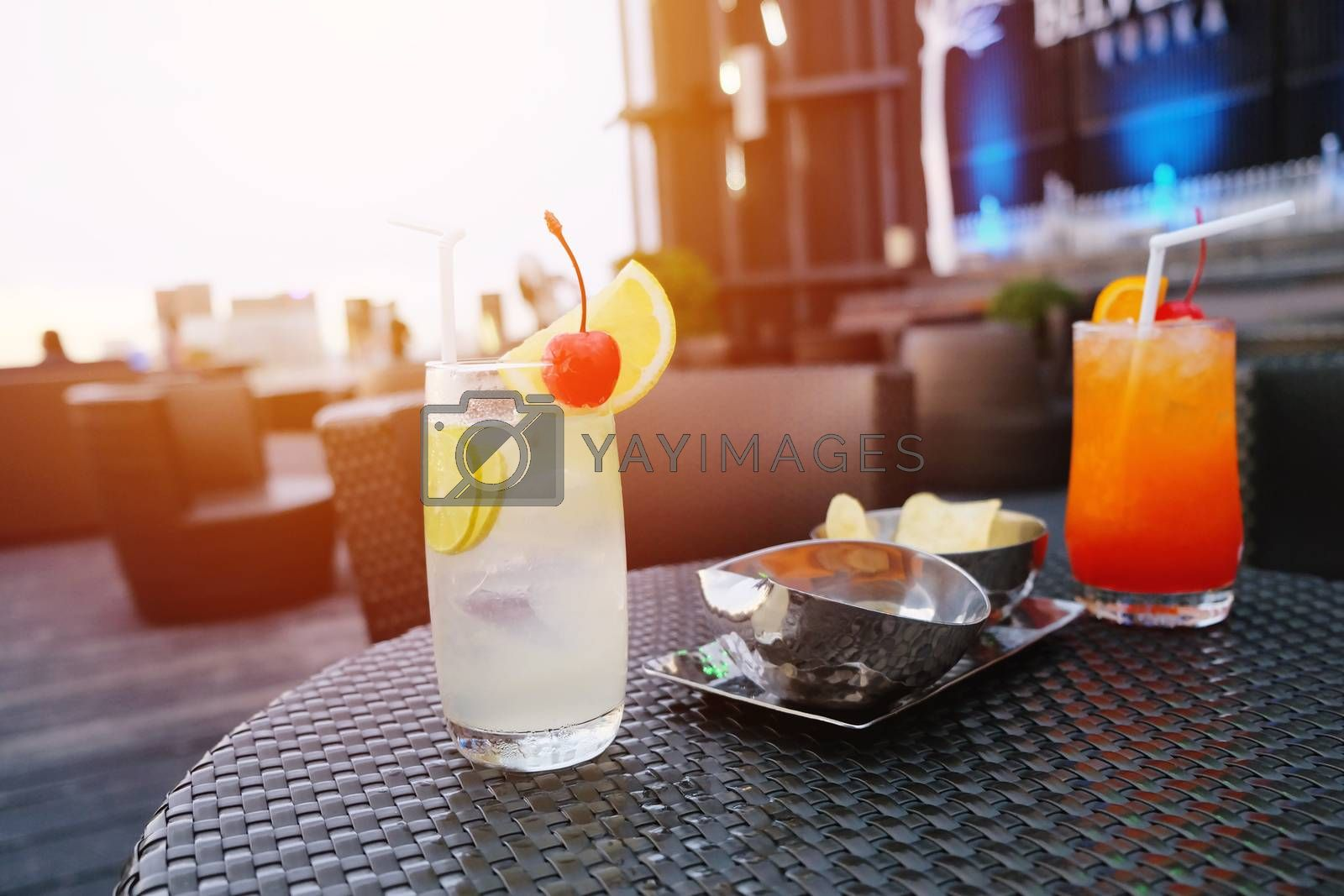 Royalty free image of Two iced cocktail glasses in rooftop bar for nightlife by nuchylee
