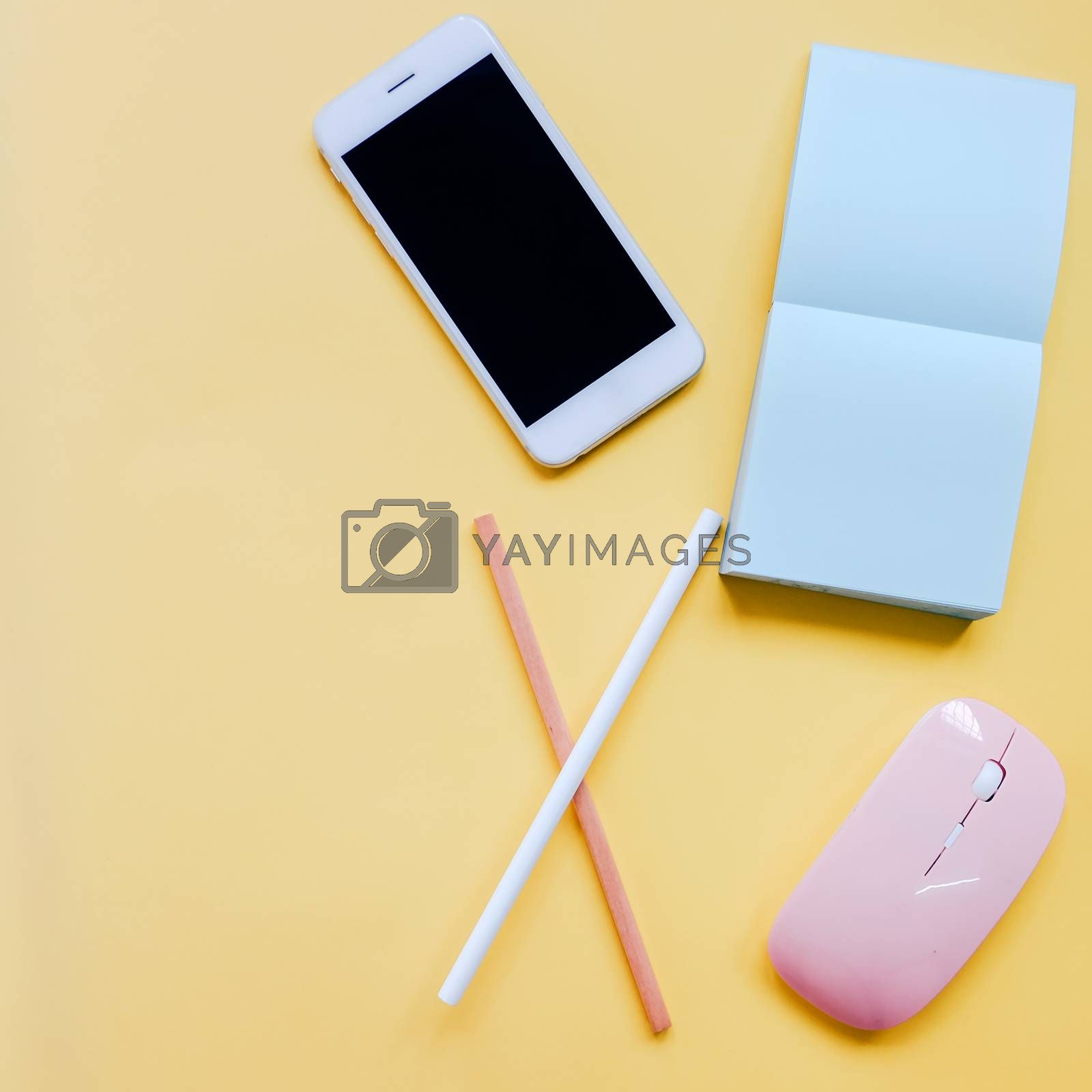 Royalty free image of Creative flat lay style workspace desk with smartphone, stationery, mouse and blank note on colorful background with copy space by nuchylee