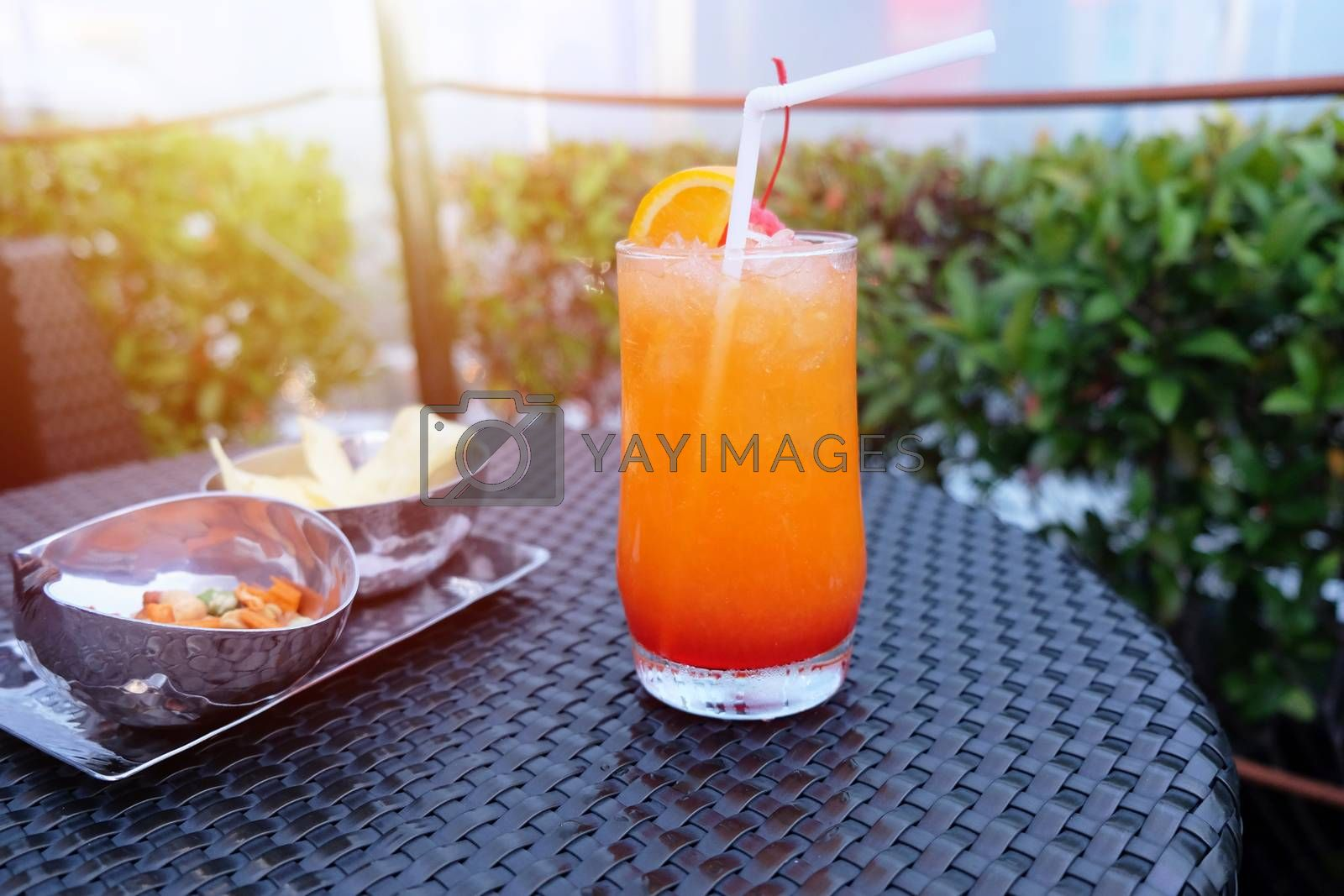 Royalty free image of Iced cocktail glass and snack on the table in rooftop bar for ni by nuchylee