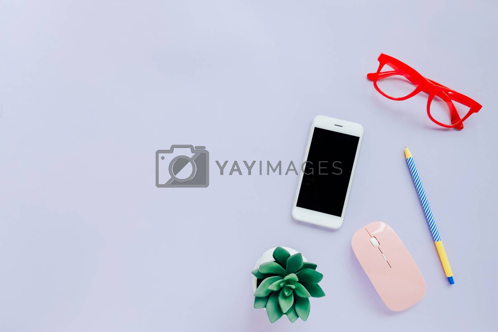Royalty free image of Creative flat lay style workspace desk with smartphone, statione by nuchylee
