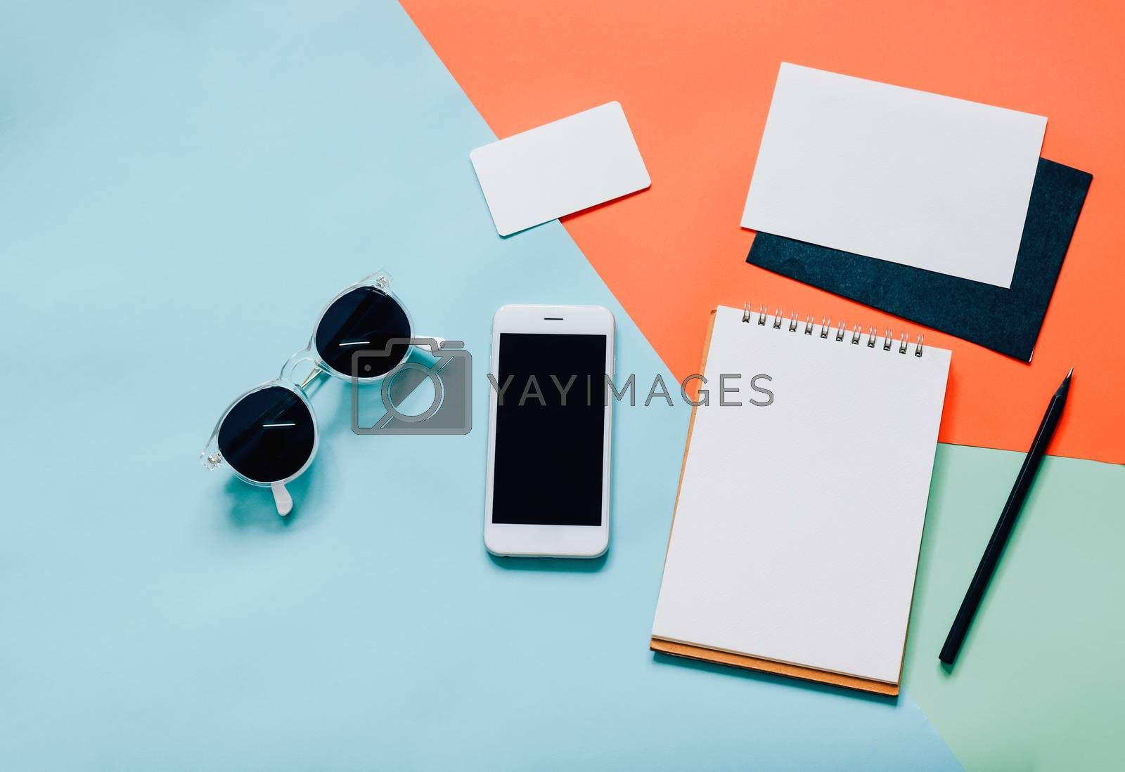 Royalty free image of Creative flat lay style workspace desk with smartphone, blank en by nuchylee