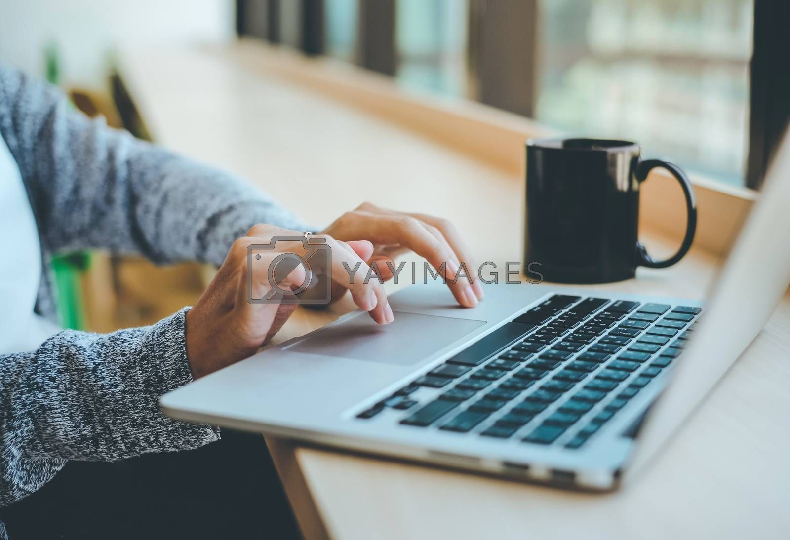 Royalty free image of Close up of young businesswoman typing on computer laptop at the by nuchylee
