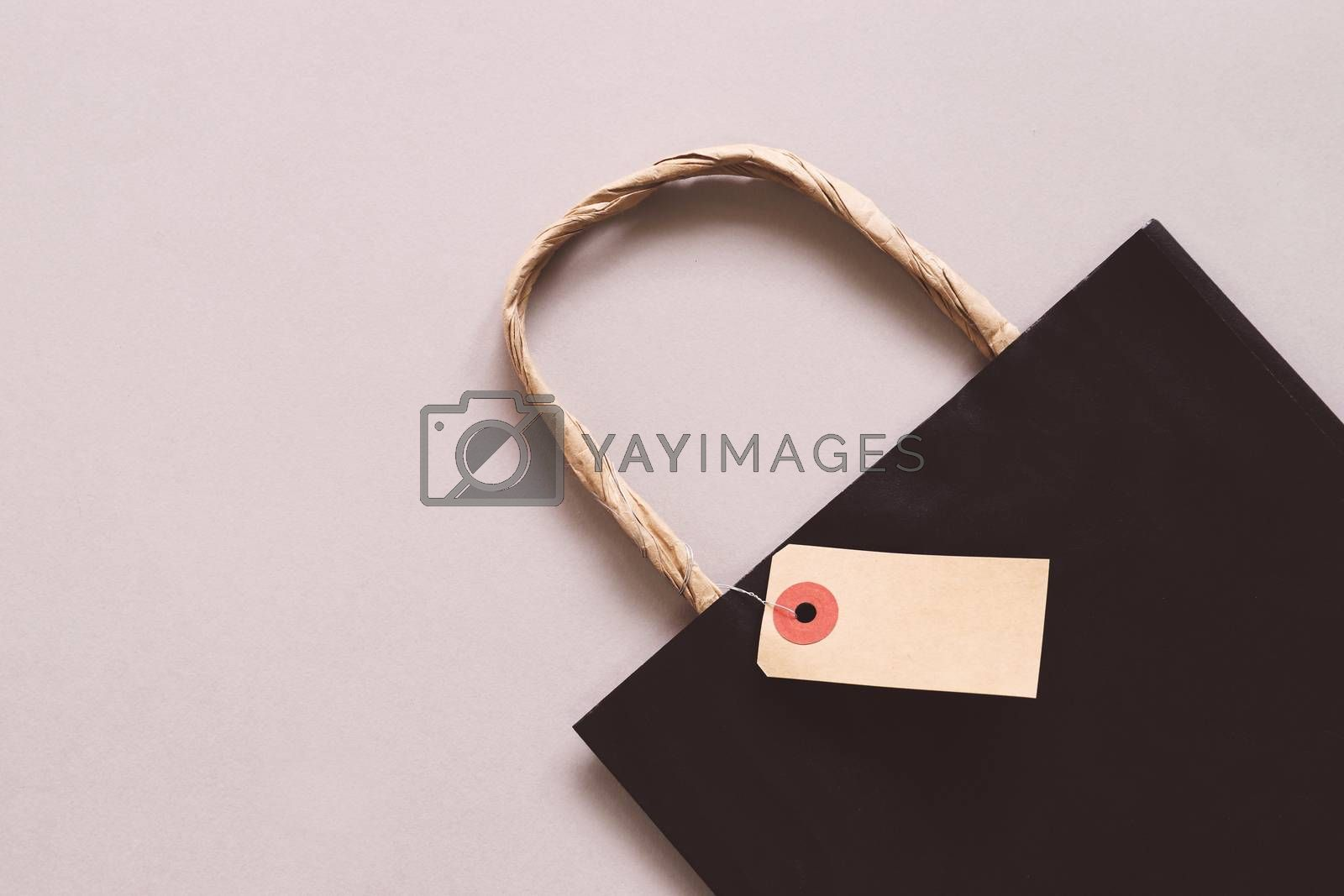 Shopping bag with blank sale tag, copy space,  shopping concept