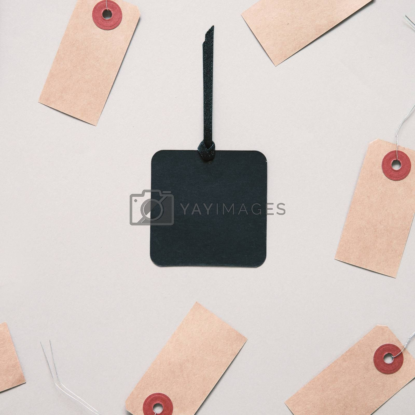 Black friday sale tag on black paper label surrounding with blank tag, shopping concept