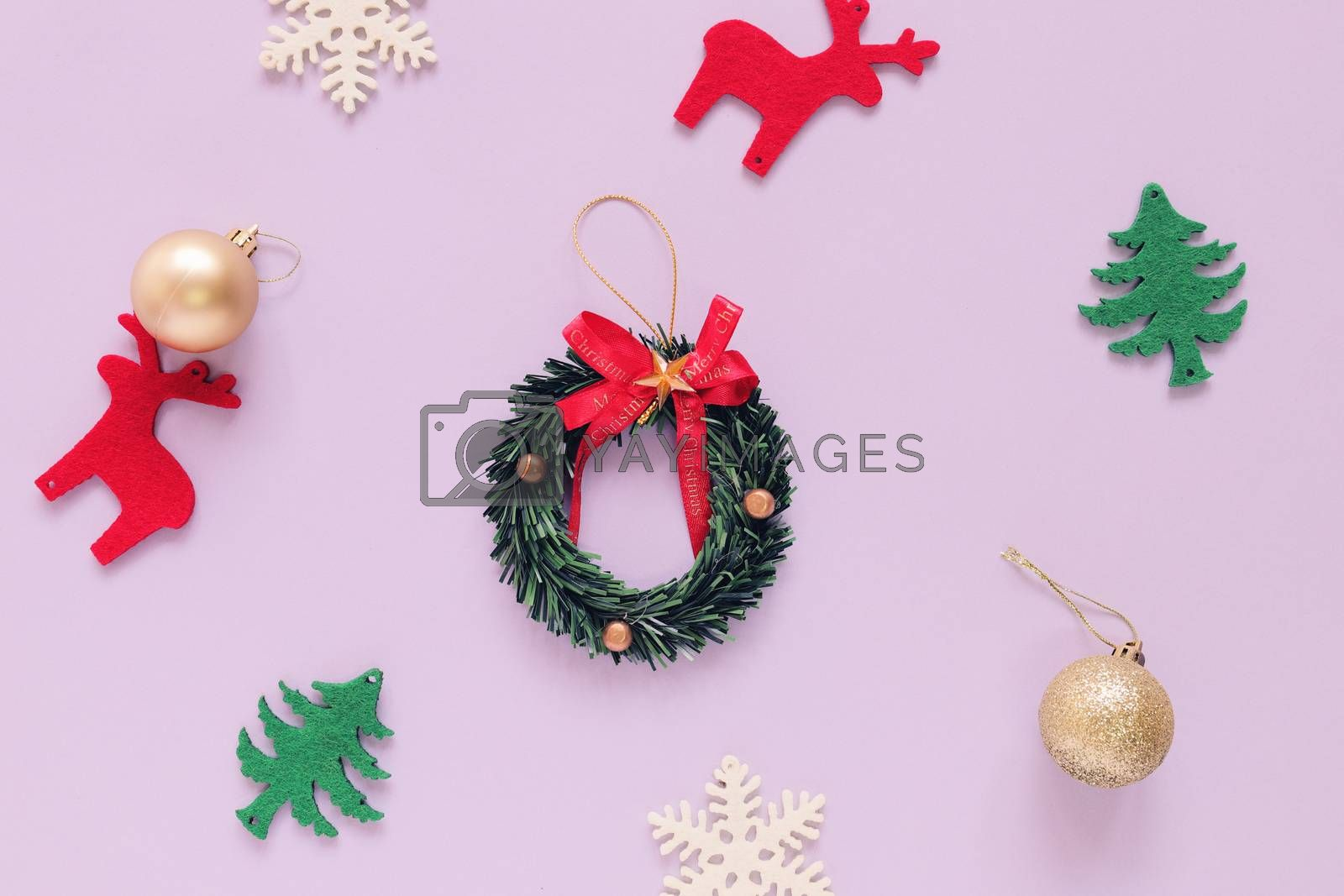 Christmas concept : Flat lay of Christmas ornaments on purple background with minimal style