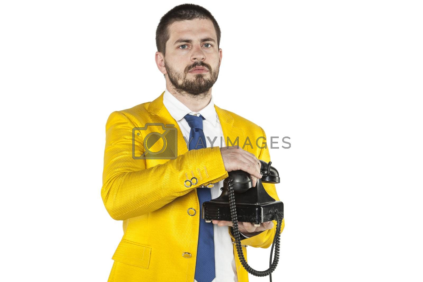 businessman in a gold suit hangs up the phone