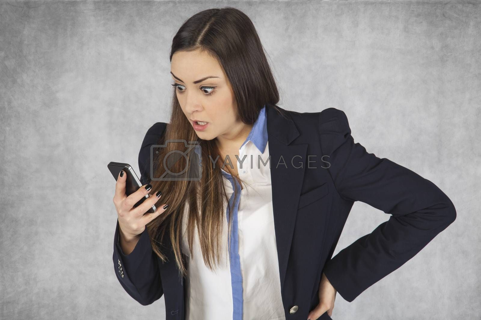 surprised business woman reading email on phone