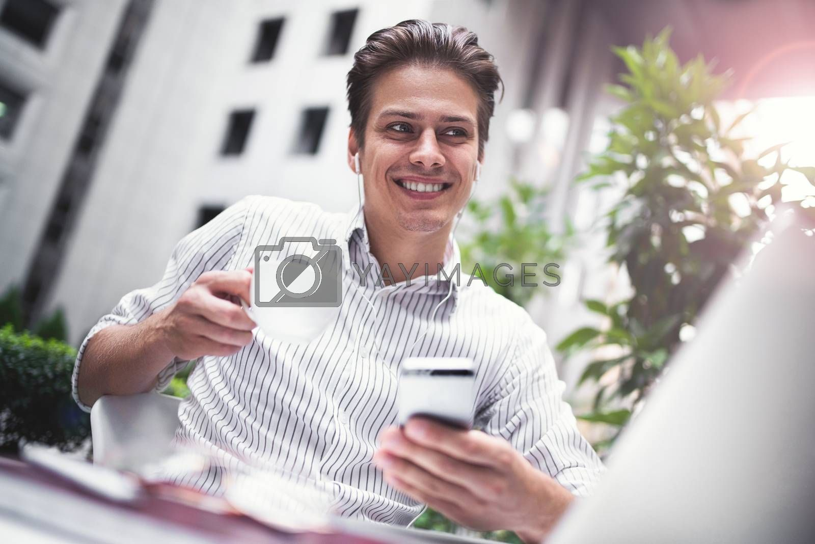 Royalty free image of Smart attitude. Positive handsome man using a laptop and sitting in the cafe while surfing the internet have a web conference. Web chat online conference. by Nickstock