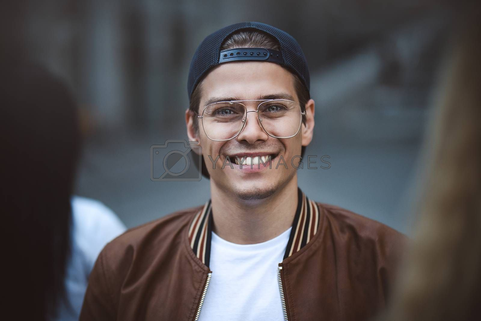 Royalty free image of Young happy man posing on a crowded street by Nickstock