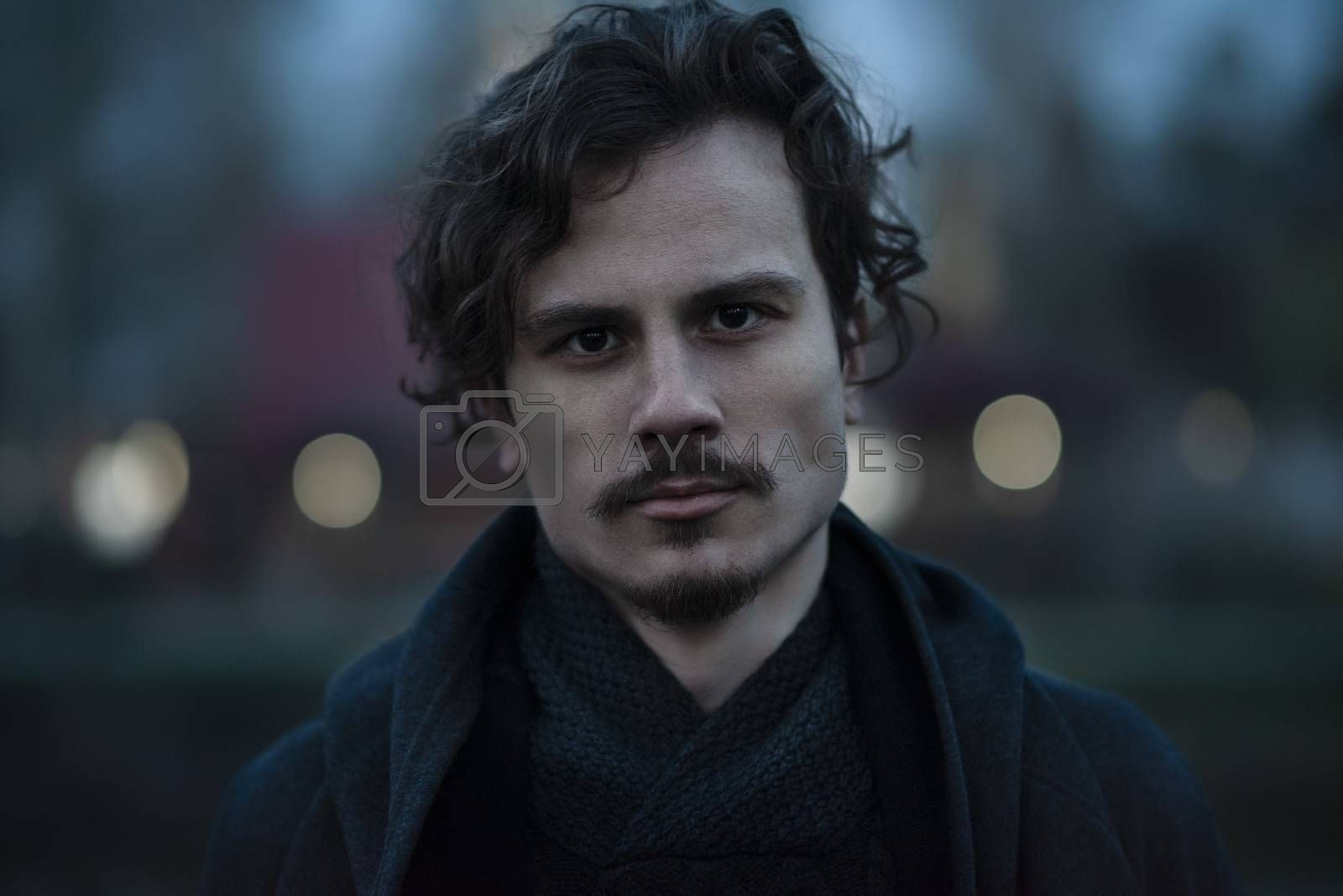 Royalty free image of Night portrait of a confident serious man in the park. earnest, tensions by Nickstock