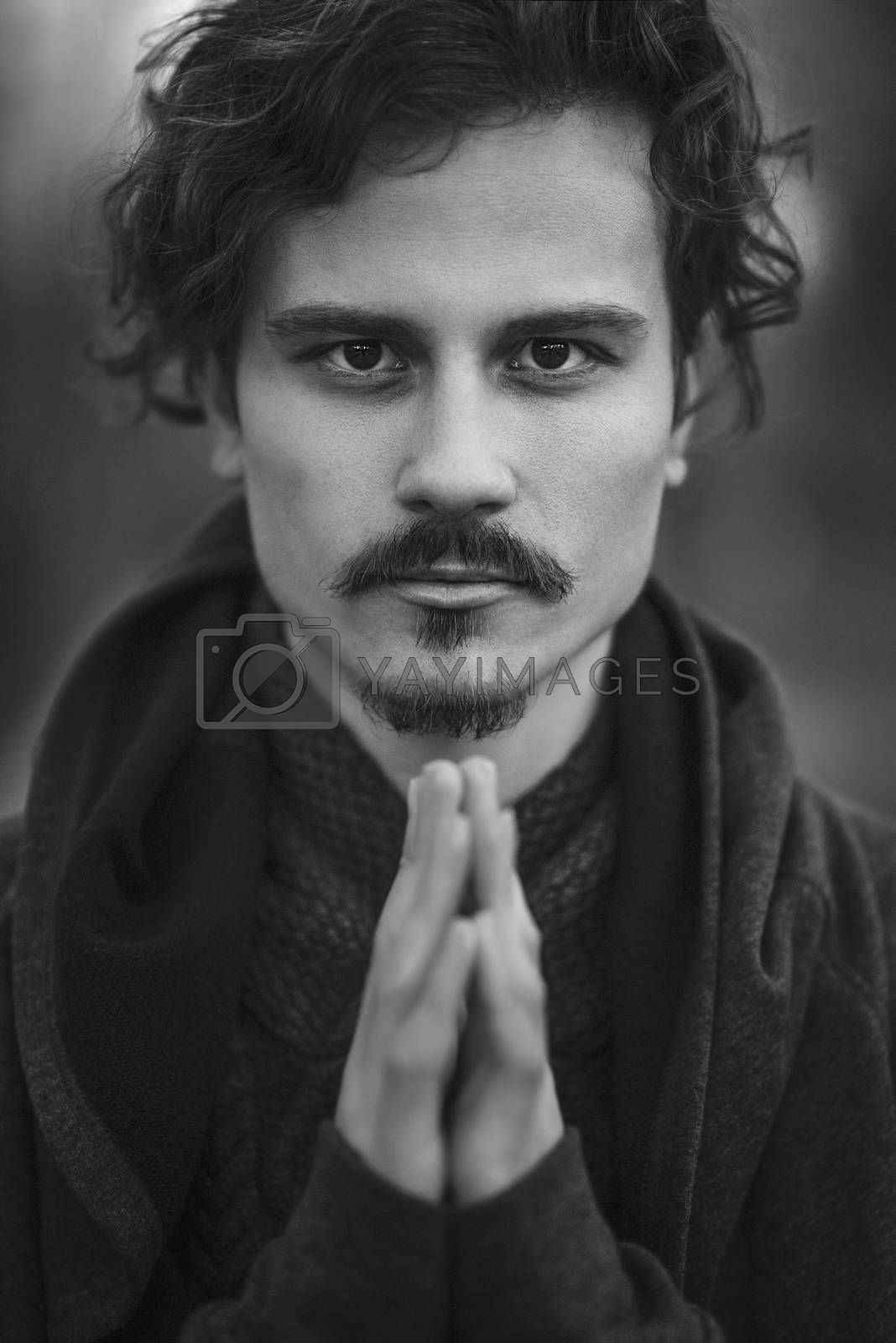 Royalty free image of Handsome young curly man sincerely praying. religion concept by Nickstock