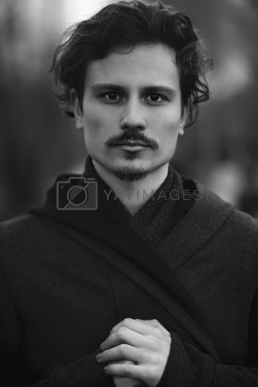 Royalty free image of Handsome young curly man sincerely prays to God by Nickstock