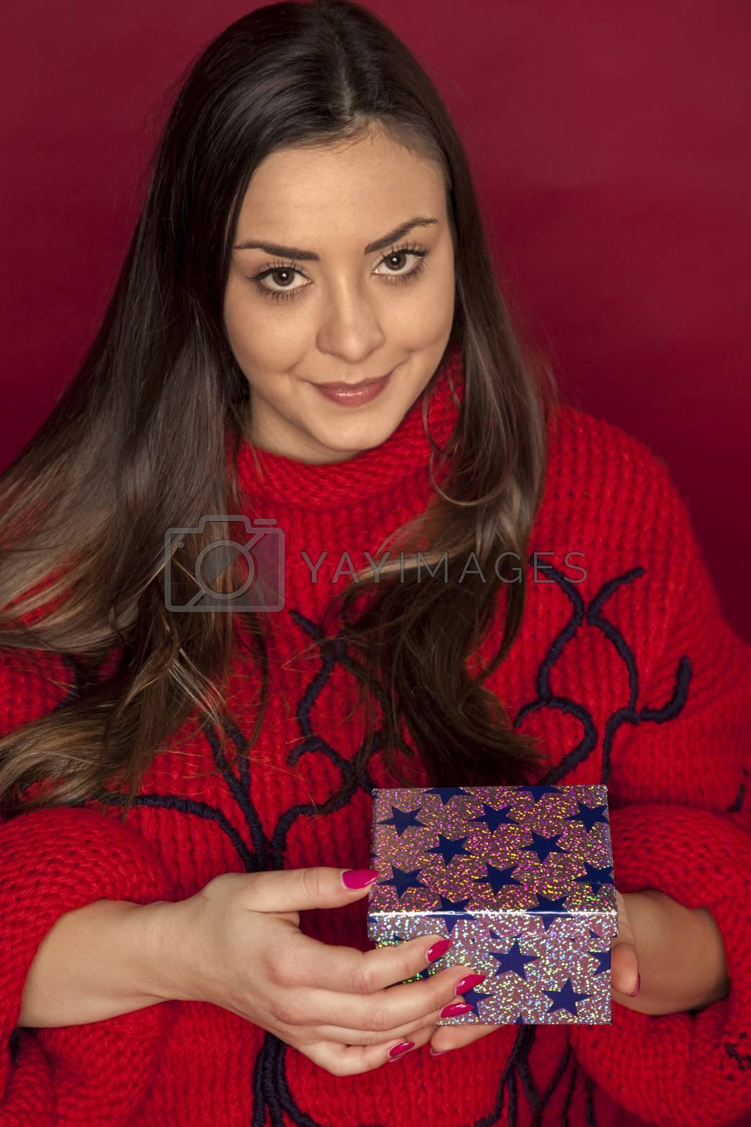 beautiful woman holding a christmas gift