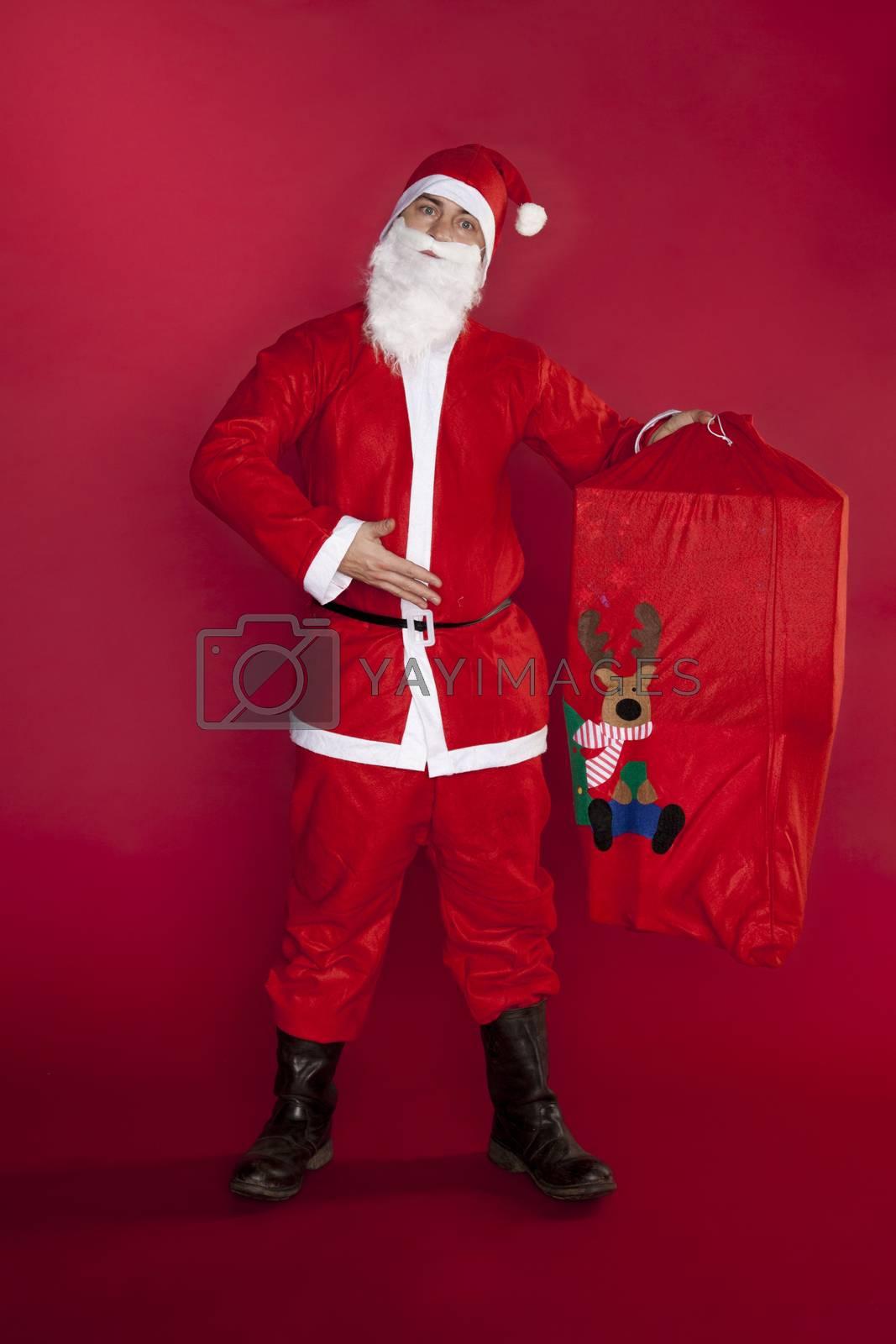 Santa Claus shows a gift bag