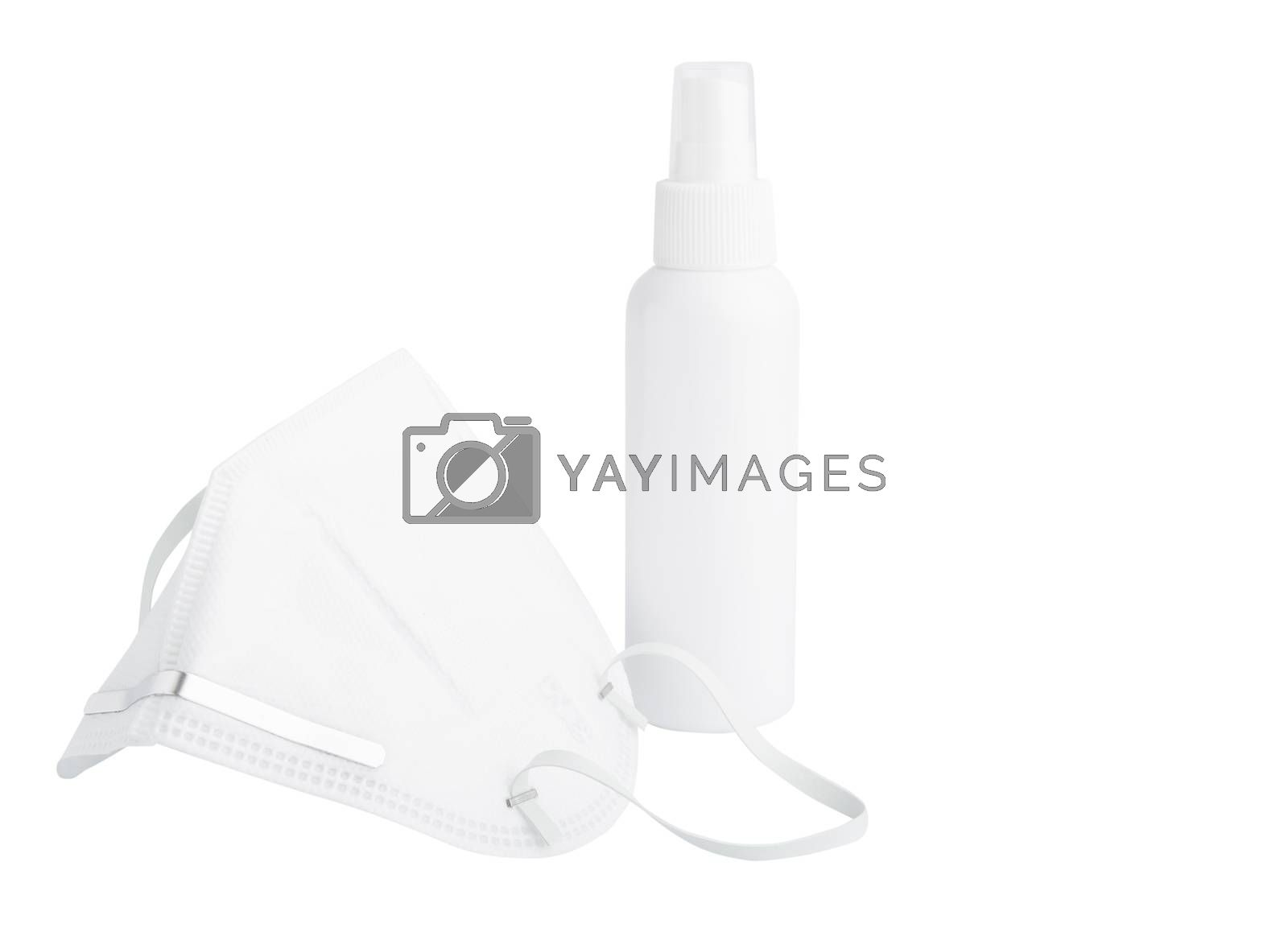 White mask for wearing germ protection  and gel alcohol or hand sanitizer spray bottle for washing hand  to protect from corona virus  isolated over white background with clipping path