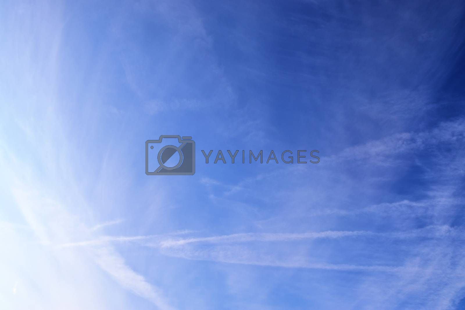 Stunning cirrus cloud formation panorama in a deep blue summer sky seen over Europe