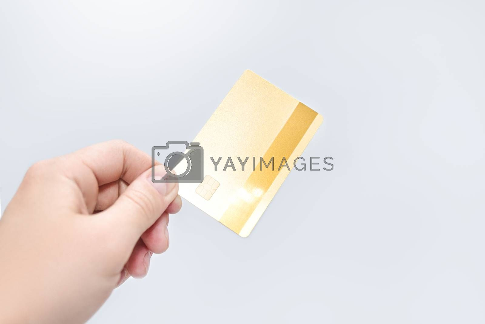 Man holding gold credit card in hand on white background. business concept. credit card payment.