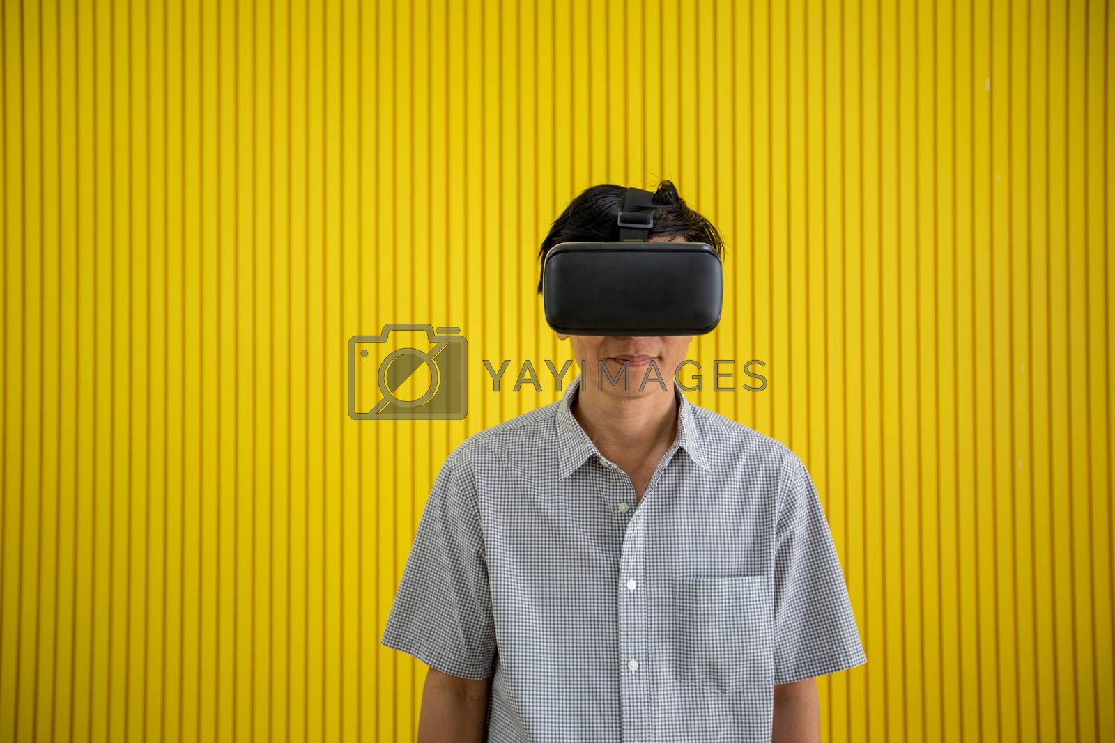 Senior Asian man using tablet and virtual reality simulator play by Tuiphotoengineer