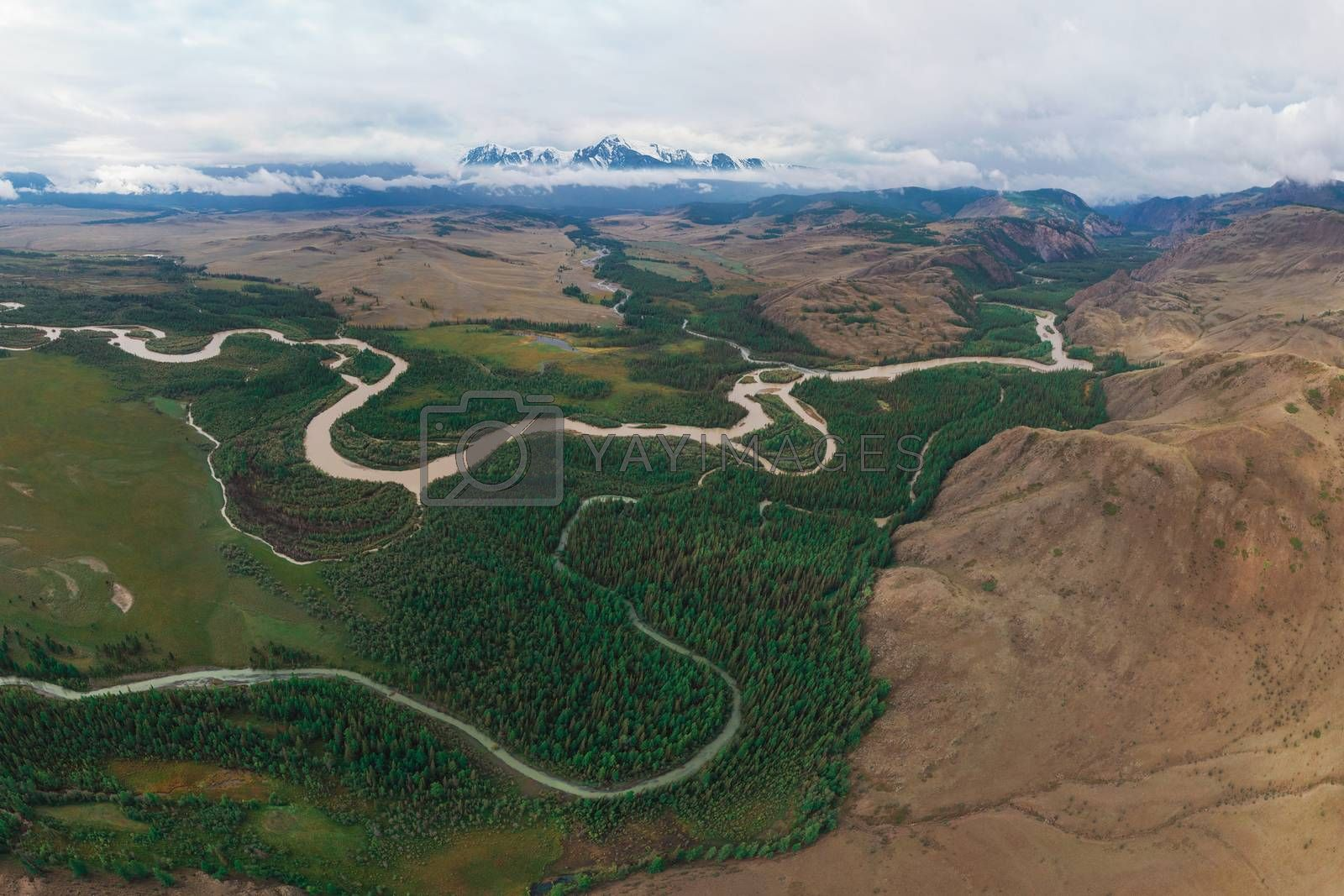 Aerial drone panoramic picture of Kurai steppe and Chuya river on North-Chui ridge background. Altai mountains, Russia.