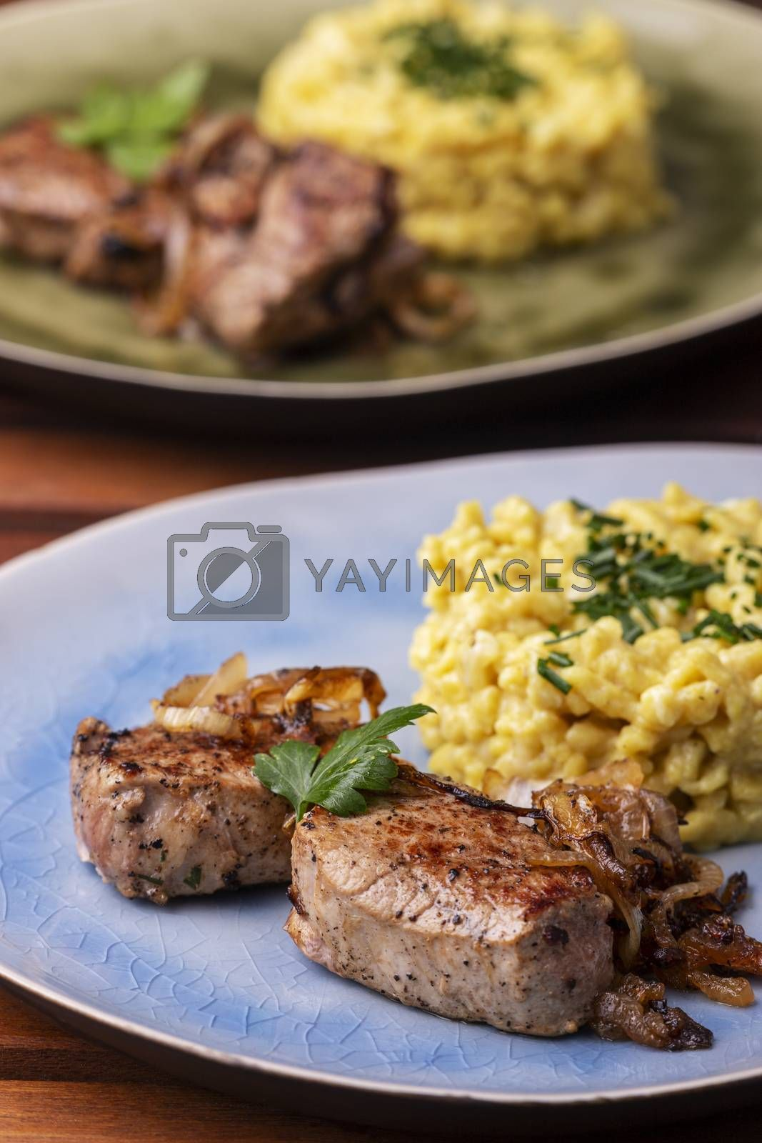 roasted pork fillet and spaetzle in a plate