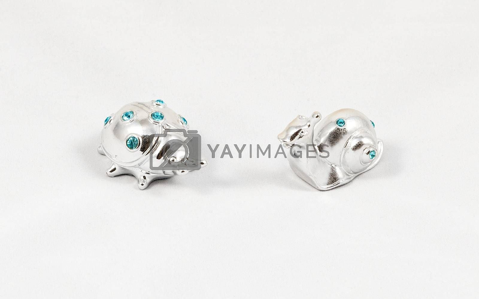 Ornamental silver snail and ladybird with gemstones, isolated on white background