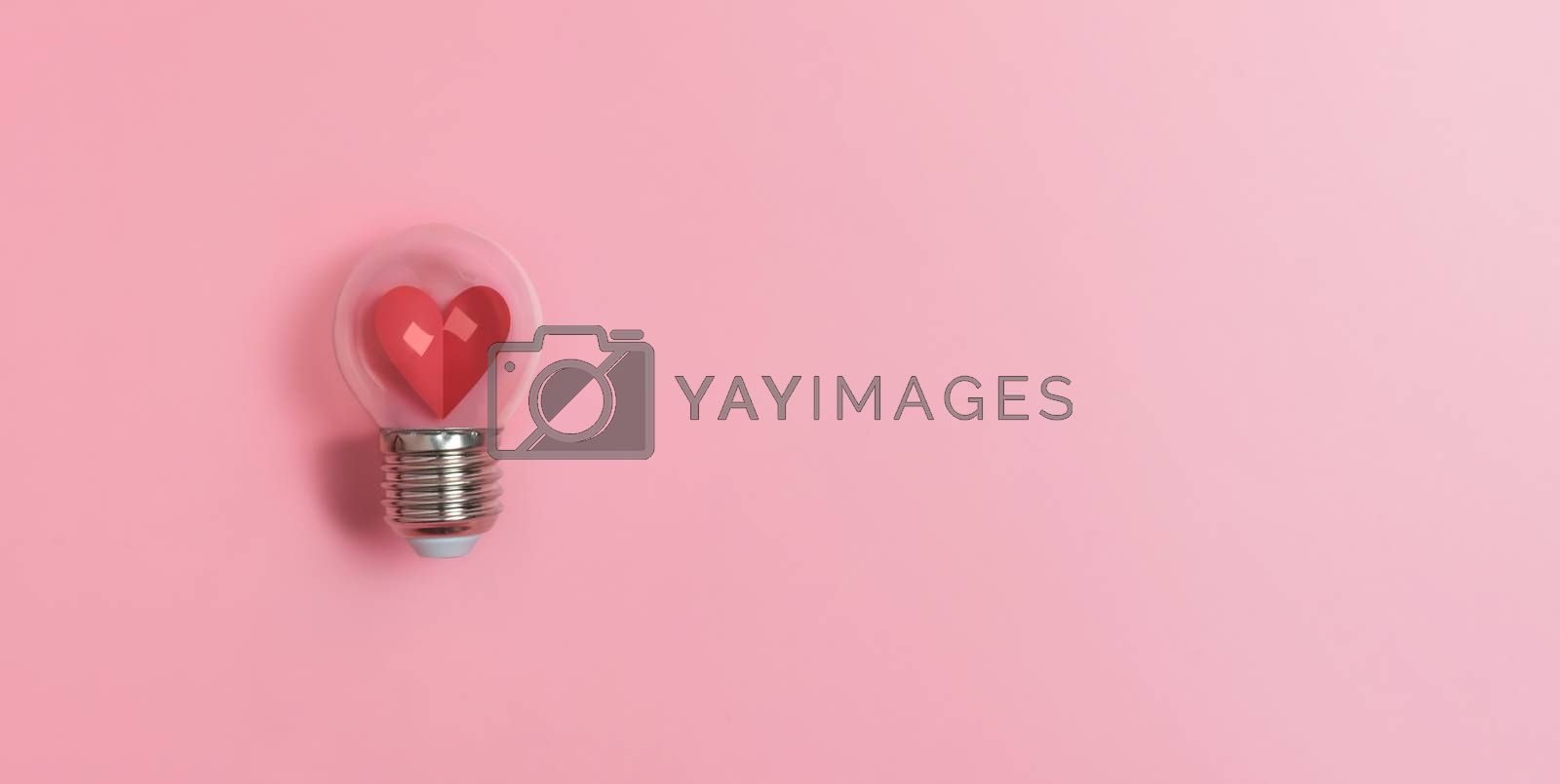 Red heart in light bulb on pink background with copy space. Valentine's day, Creative idea, Inspiration Concept.