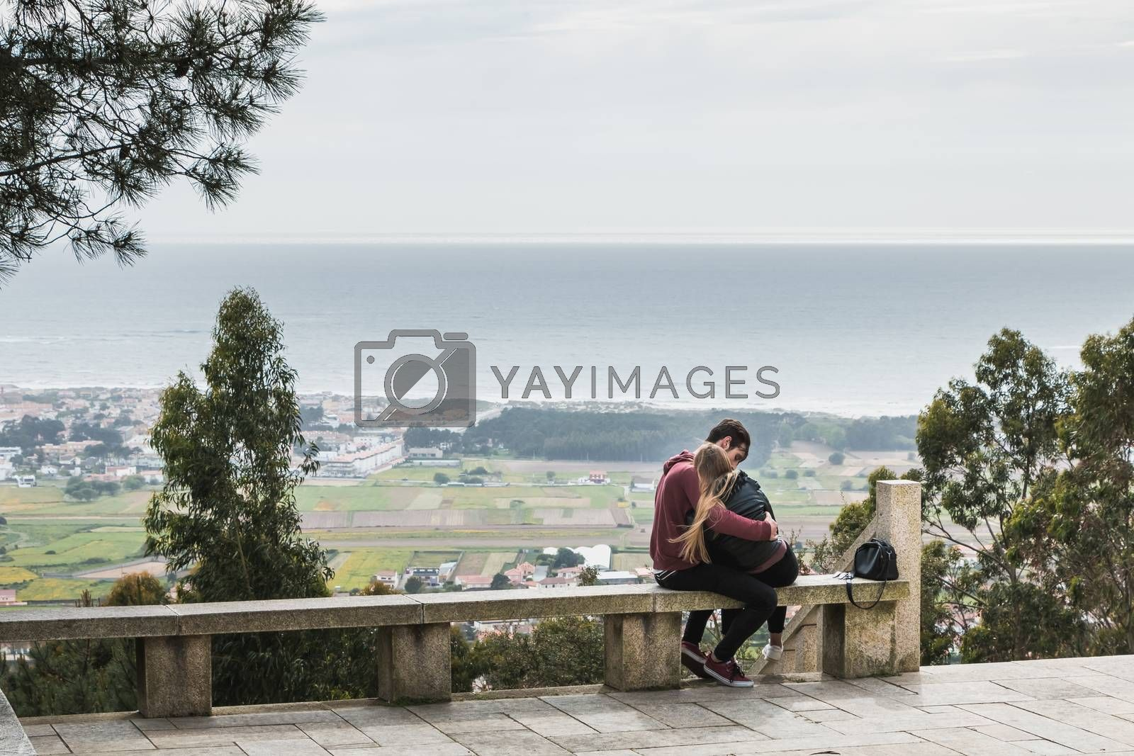 Vila Cha near Esposende - May 9, 2018: couple enjoying the panoramic view of Esposende on the entrance to the chapel of S. Lourenco on a spring day