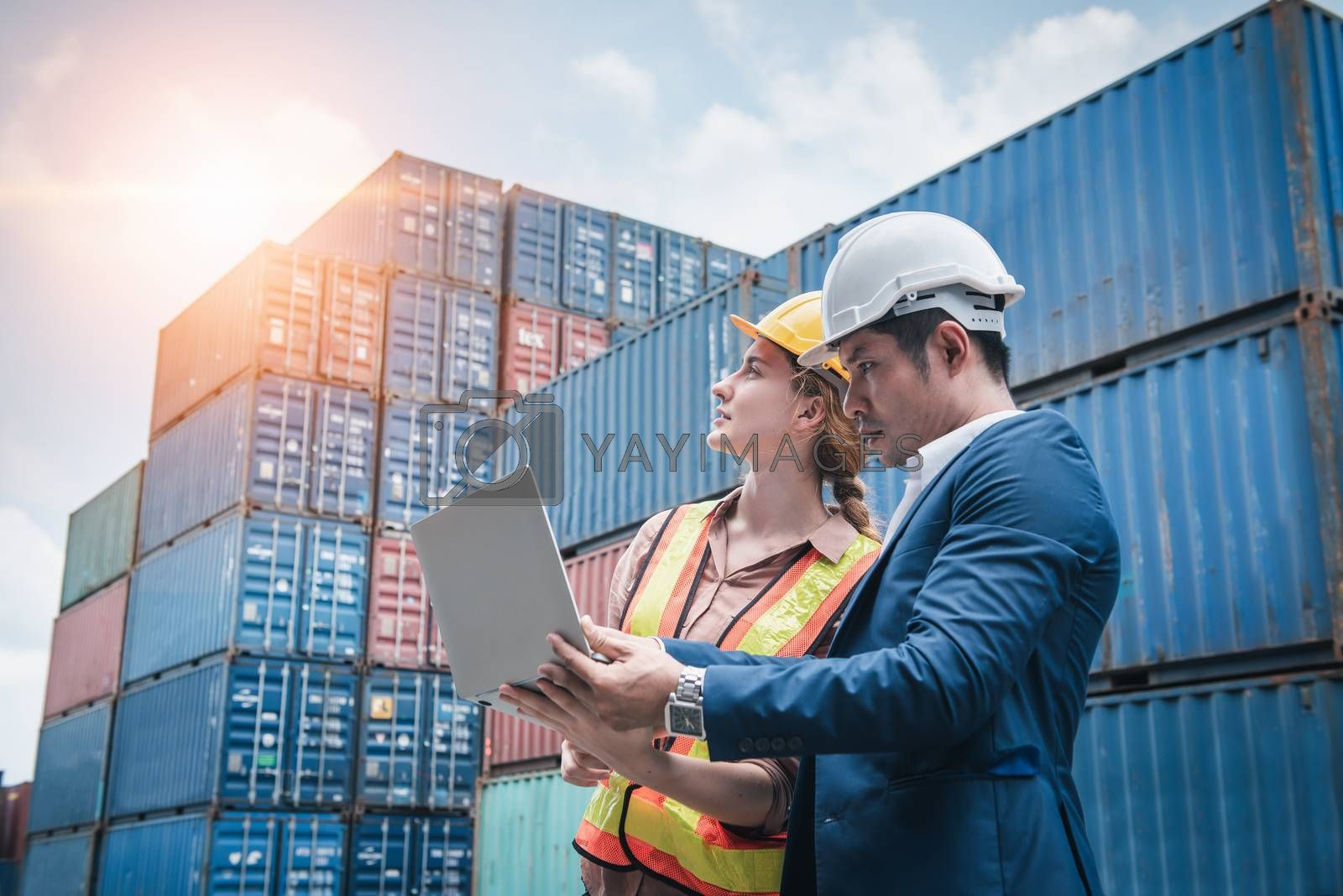 Business Team Container Cargo Shipping Control Inspection Loading Dock and Management Import/Export Freight at Port Ship Yard. Manager and Foreman Teamwork Inspecting Containers Shipment Warehouse.