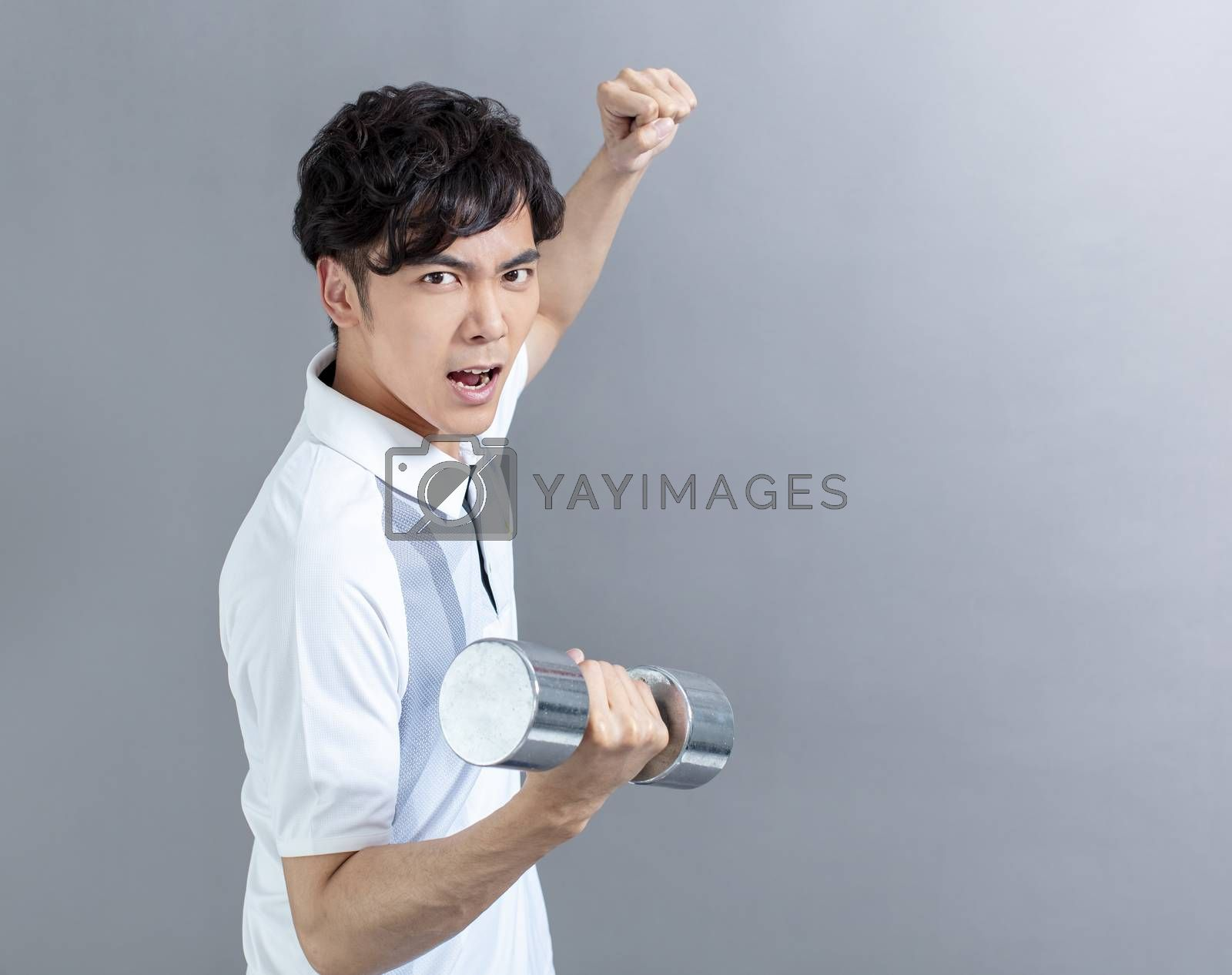 asian young man doing exercise with dumbbell by tomwang