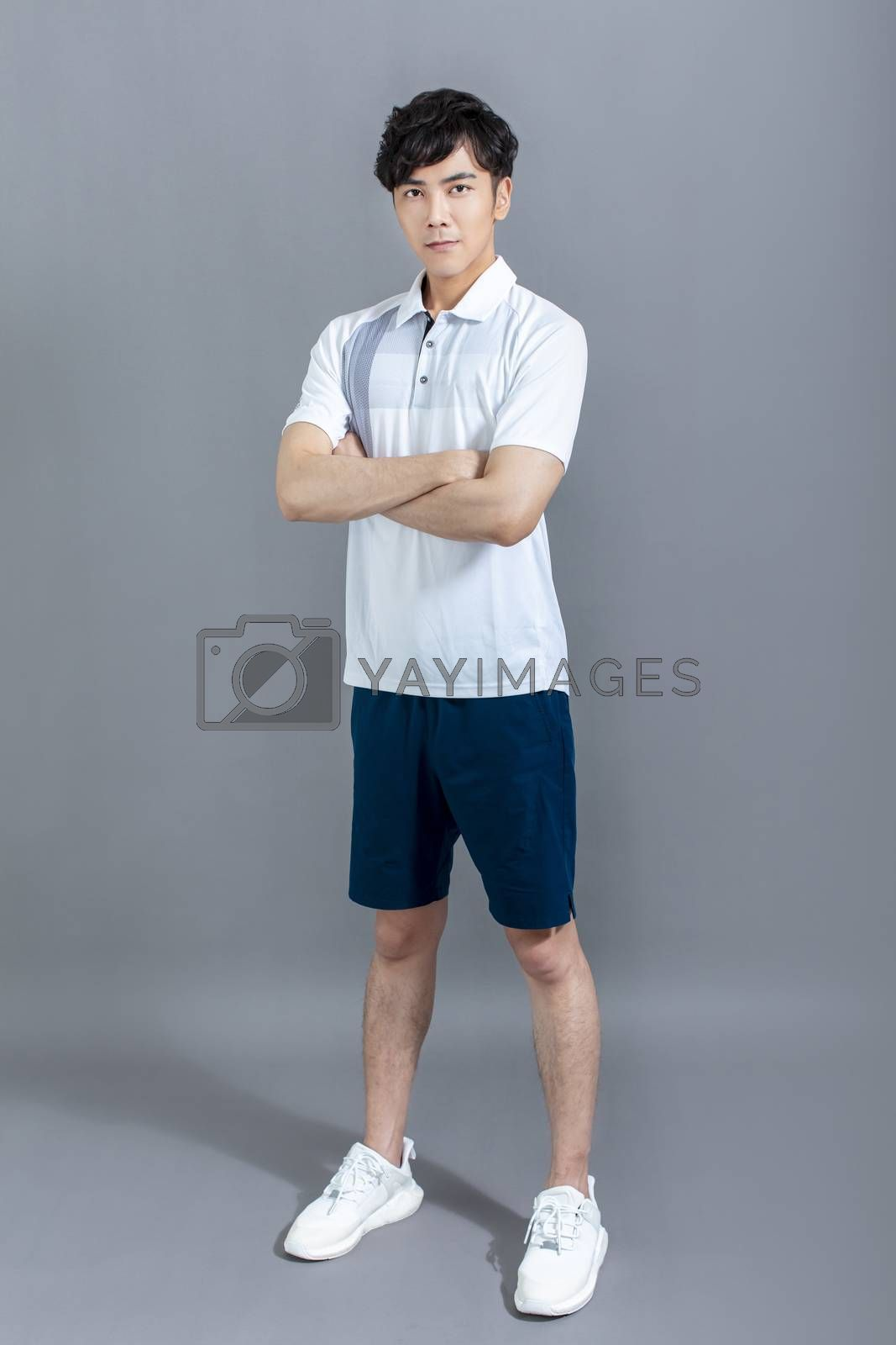 Full length portrait of young  athlete man isolated  by tomwang