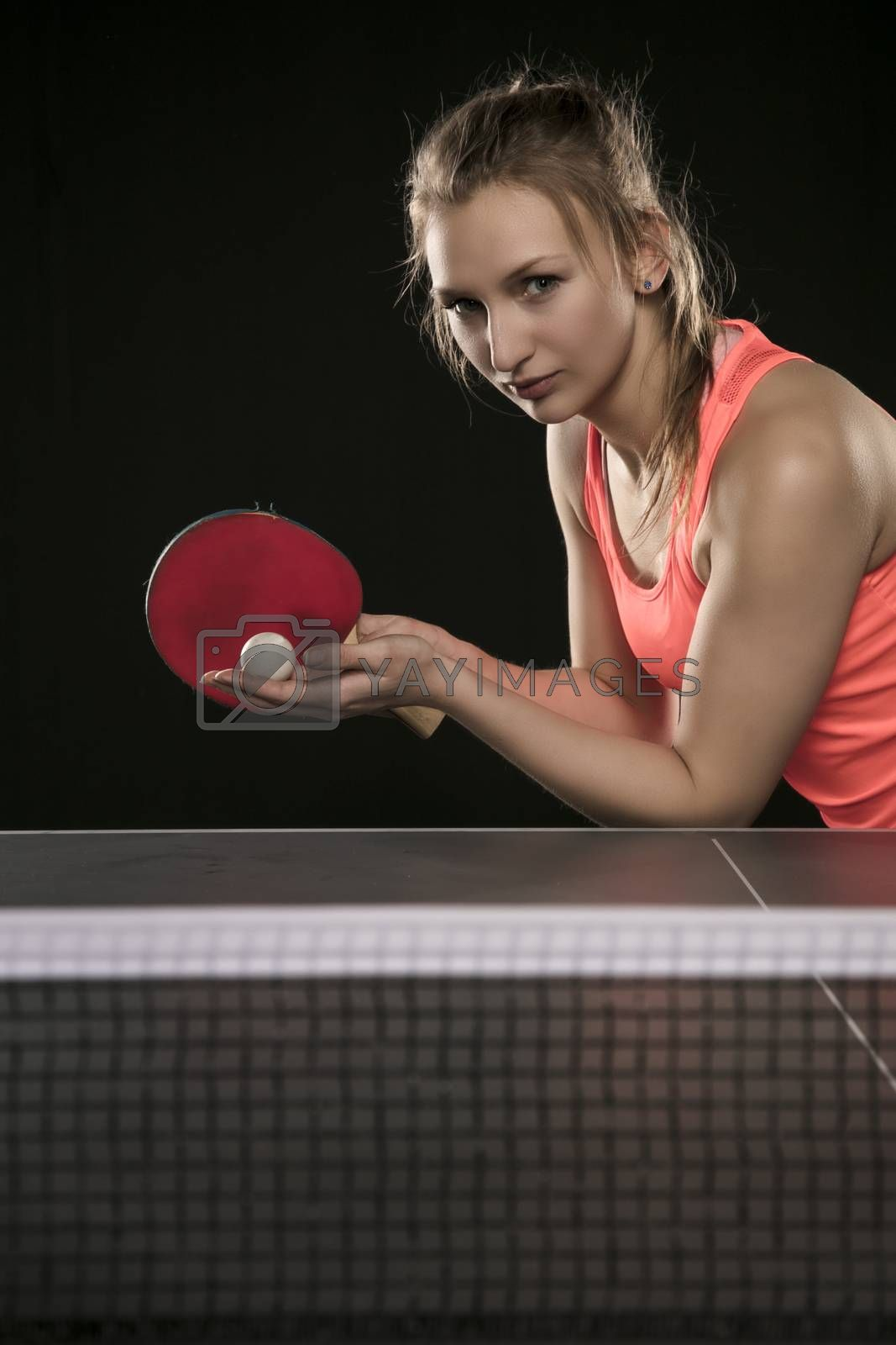 young beautiful athletic girl playing ping pong
