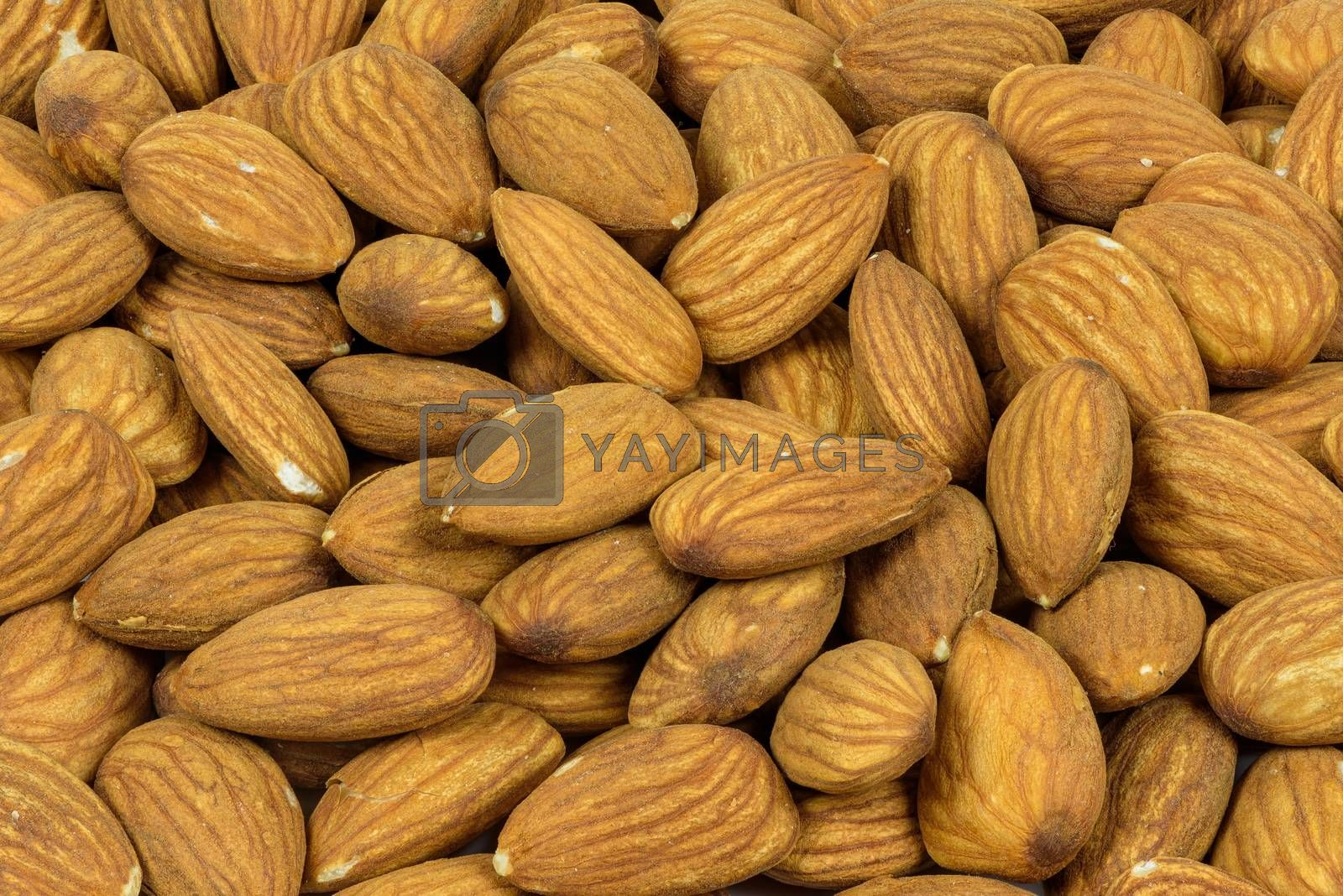 Top view of of heap of almonds as a natural background
