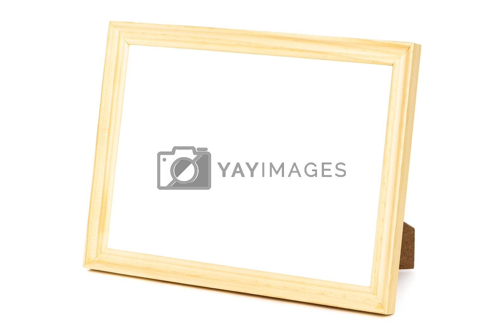 Royalty free image of Standing wooden picture frame on white background by mkos83