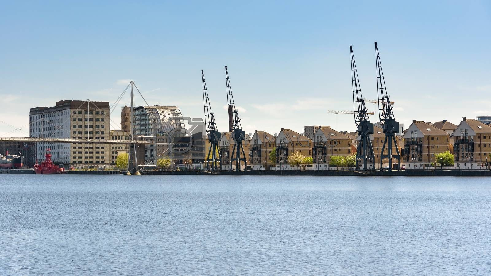 Royalty free image of Panoramic view of houses at Royal Victoria Dock in London by mkos83