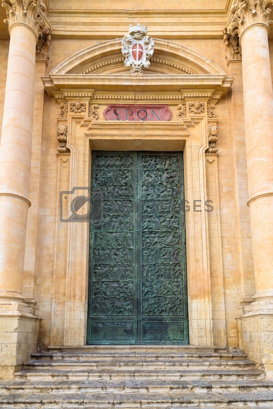 Royalty free image of Carved door of Saint Nicholas of Myra Cathedral in Noto by mkos83