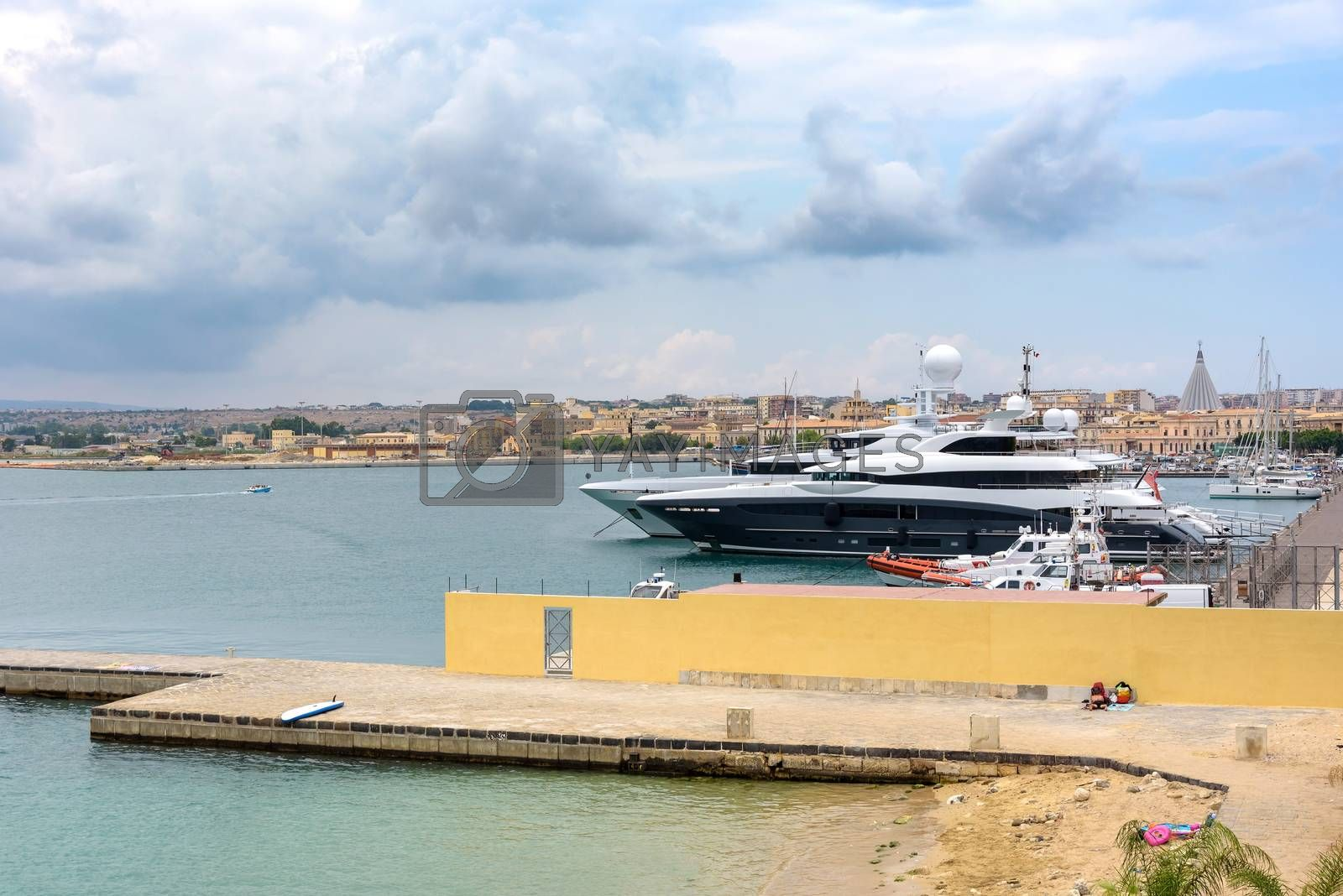 Royalty free image of Luxury yachts moored in the port on Ortygia Islands in Syracuse by mkos83