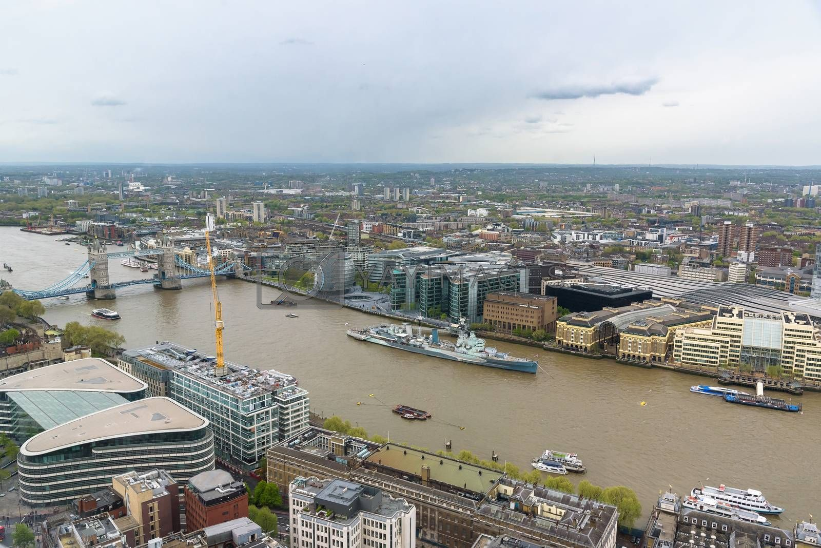 Aerial view of the river Thames in London on a cloudy day, UK