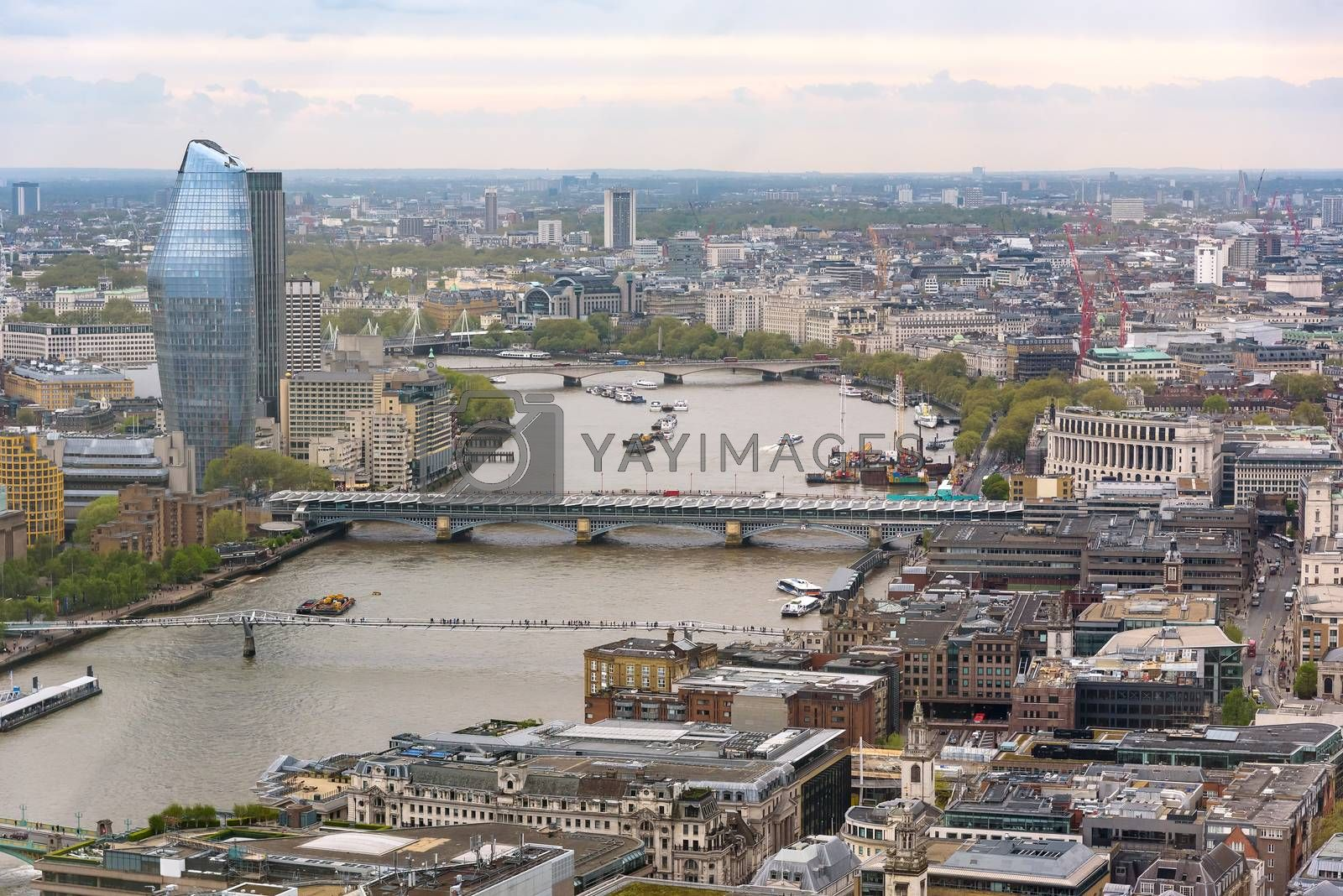 Aerial view of Thames river in London on a cloudy day