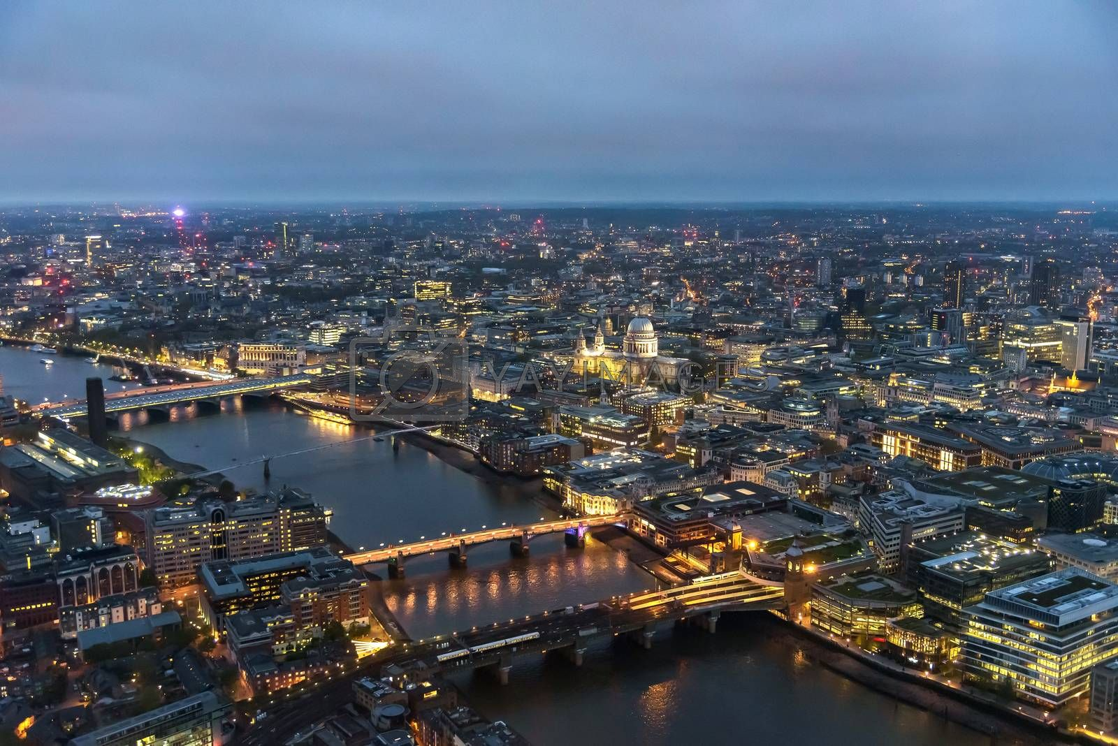 Royalty free image of Aerial view of river Thames in London at dusk by mkos83