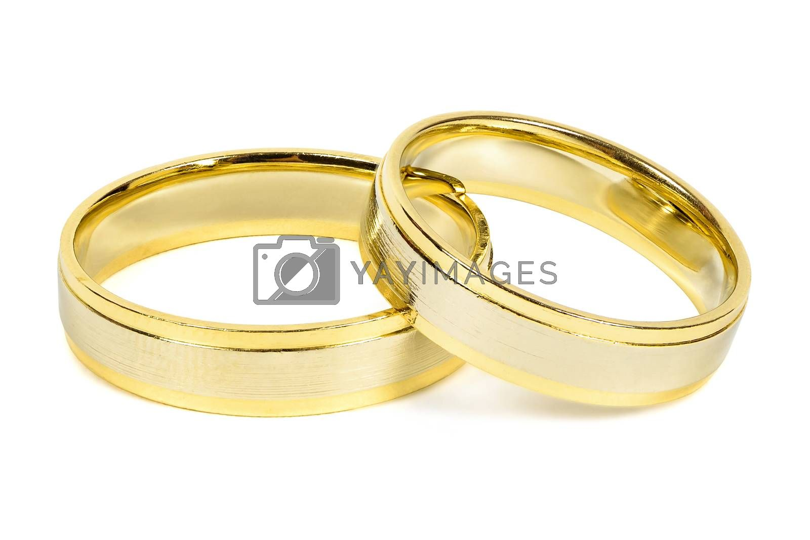 Royalty free image of Wedding rings on white background by mkos83