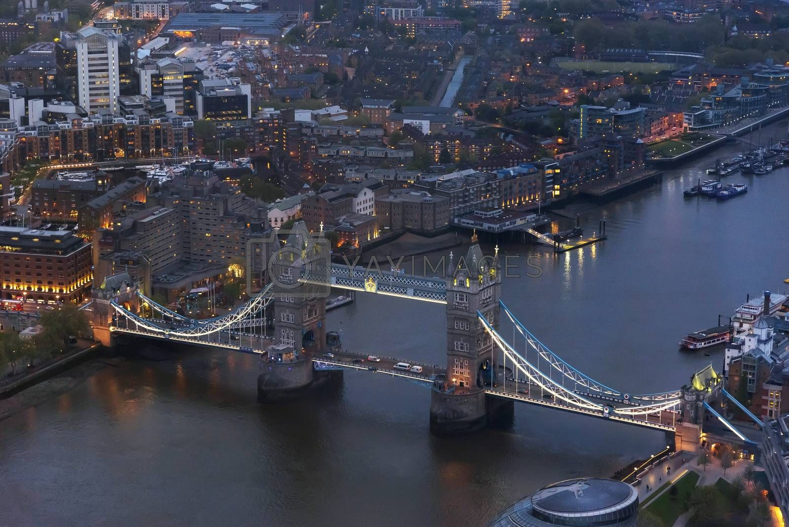 Aerial view of Tower Bridge in London at an overcast day at dusk