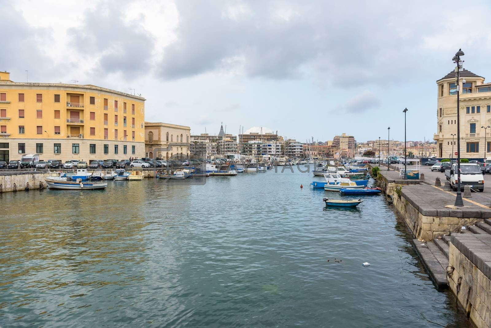 Boats moored in small sea port in Syracuse, Sicily, Italy
