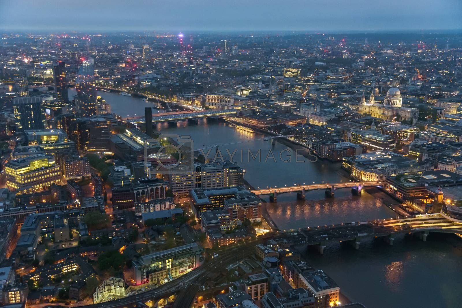 Aerial view of river Thames in London on a cloudy day at dusk
