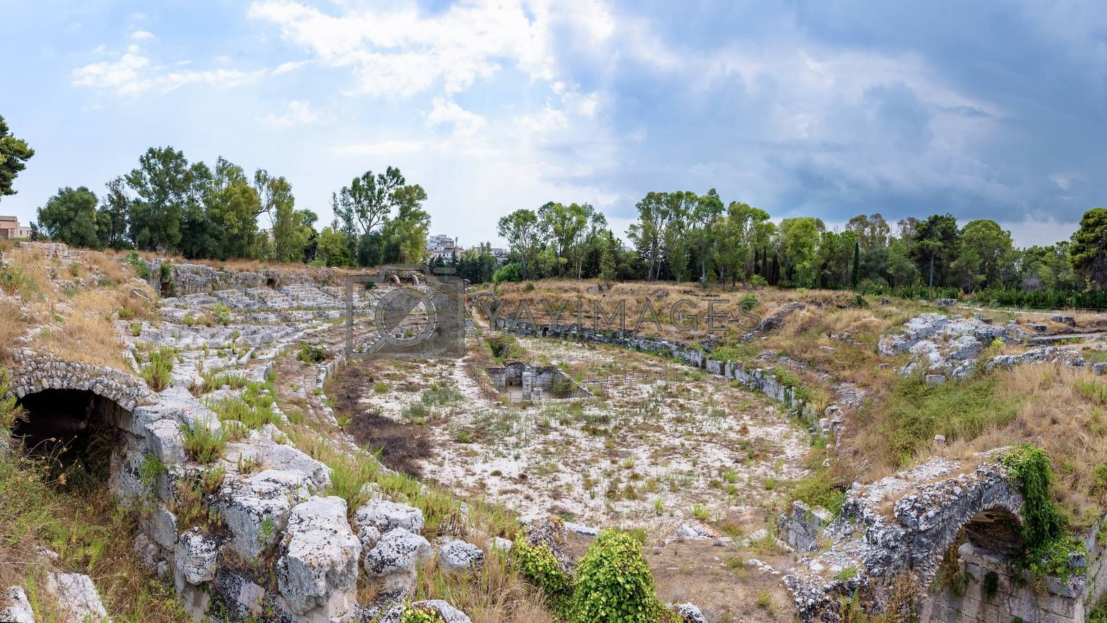 Panoramic view of ruins of the ancient roman Amphitheatre in Syracuse (Anfiteatro romano di Siracusa), Sicily, Italy