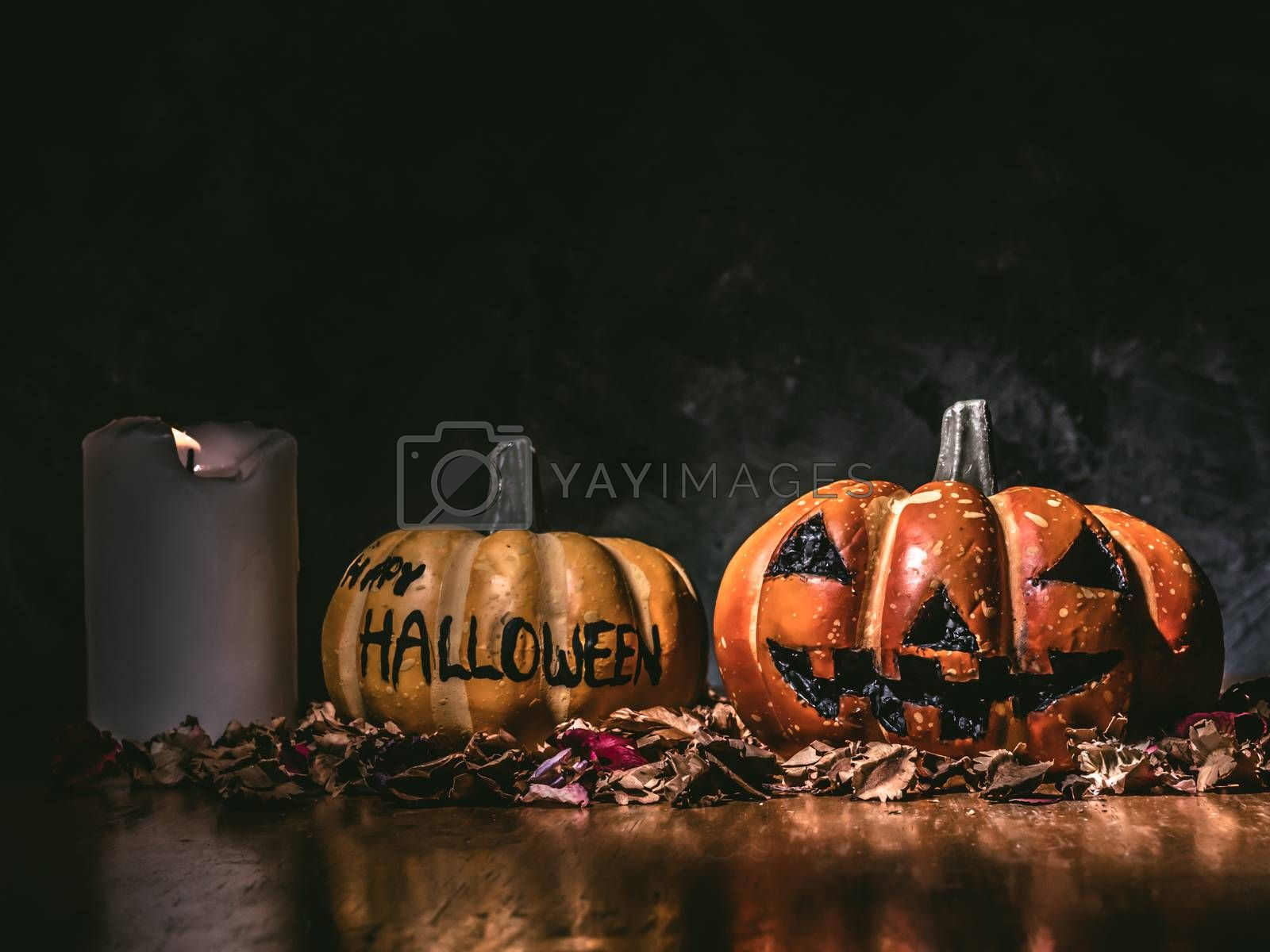 Halloween pumpkins with candlelight on dark background.