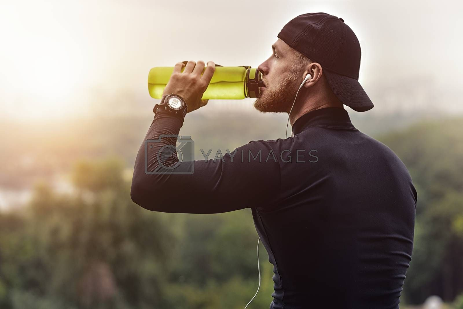 Close-up Shot Bearded Sportive Man take a rest and drink a water After Workout Session.