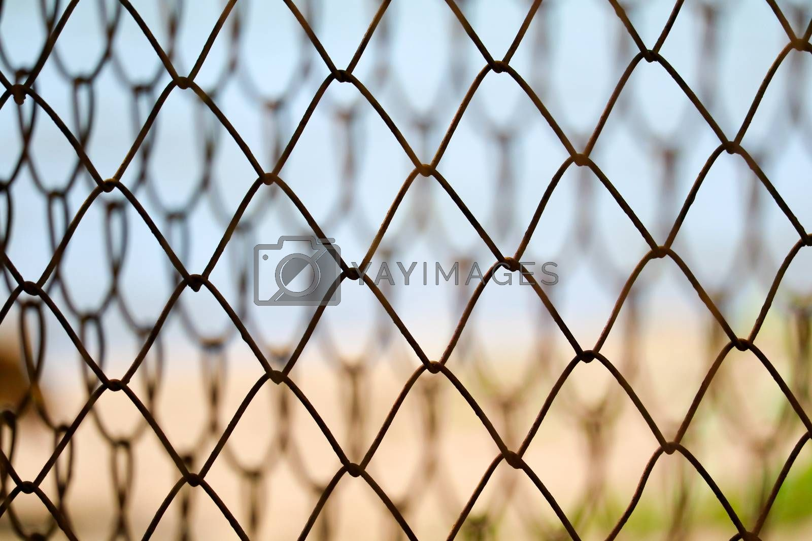 Steel wire fence to prevent dangerous areas along the beach and blur background